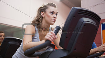 Woman riding in a spinning class