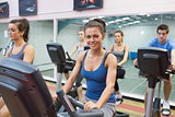 Woman smiling at spinning class