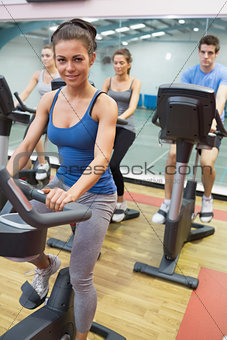 Woman enjoying spinning class