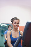 Woman on exercise bike in spinning class