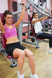Women working out on weight machines
