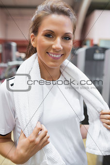 Smiling woman wearing a towel around her neck