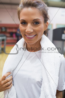 Woman wearing a towel around her neck