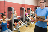 Trainer in weights room with women