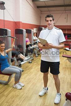 Man teaching his fitness class in weights room