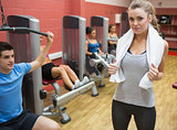 Female trainer teaching her fitness class