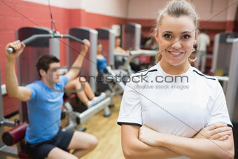 Female trainer smiling in front of class