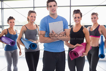 Trainer with his yoga class