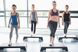 Four women doing aerobics