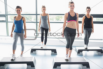 Four women doing aerobics
