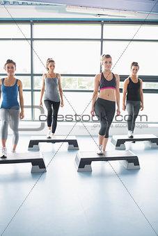 Aerobics group stepping