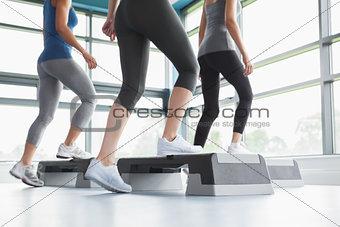 Three women doing aerobics