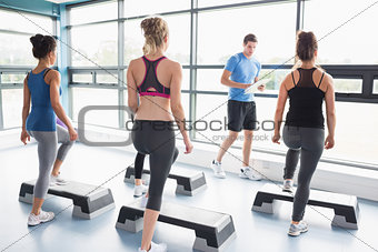 Trainer teaching his aerobics class