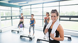 Smiling woman at aerobics class