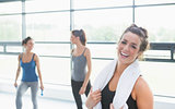 Woman smiling in fitness studio
