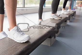 Women's feet stepping in aerobics class