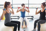 Three woman on exercise balls