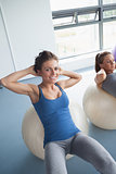 Women training on exercise ball