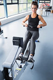 Woman training hard on row machine