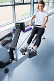 Energetic woman training on row machine
