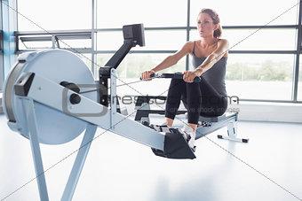 Woman training on row machine