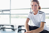 Woman sitting in fitness studio