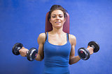 Woman lifting weights while lying