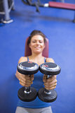Brunette lifting weights
