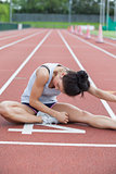 Woman stretching on a track
