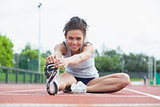 Woman stretching before race