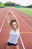 Happy woman stretching her arms