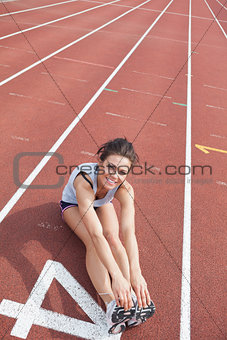Female runner stretching her legs