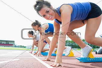 Happy woman at starting blocks