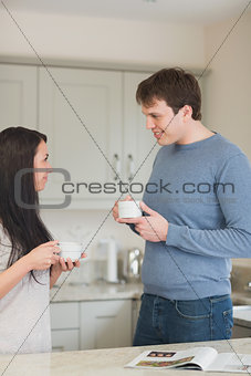 Young couple having a cup of coffee
