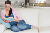 Young woman relaxing while reading a book