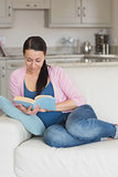 Young woman reading in the living room