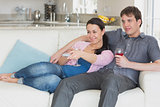 Young couple relaxing in the living room