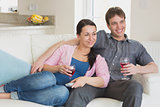 Young relaxing couple drinking wine