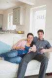 Young relaxing couple in the living room