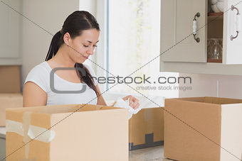 Woman unpacking in kitchen