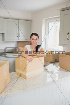 Young woman unpacking in the kitchen