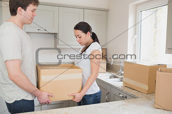 Relocating couple in the kitchen