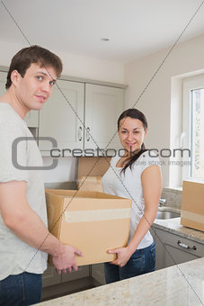Young couple holding a box