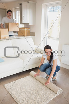 Two young people furnishing the house