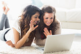 Two women using video chat on laptop