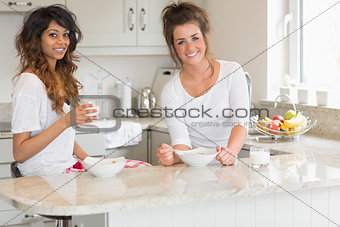 Friends eating bowls of cereal