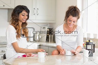 Two friends chatting over coffee at breakfast