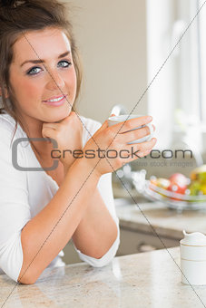 Smiling woman having coffee
