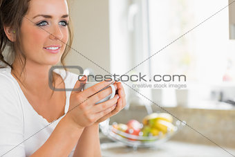 Happy woman having coffee