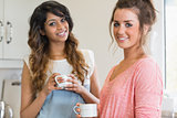 Happy women holding coffee cups